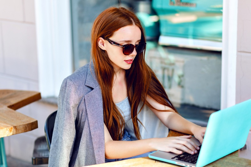 Fashionable Redhead Woman Blue Laptop Sunglasses Blazer