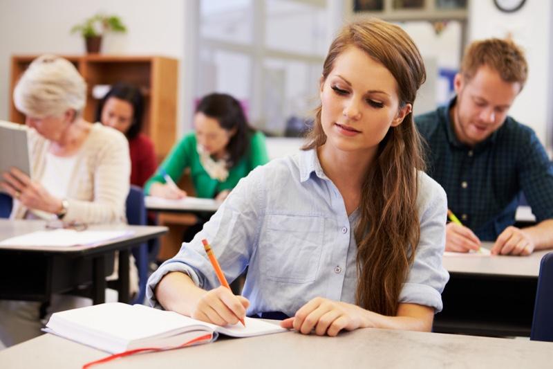 Female Student Writing Notes