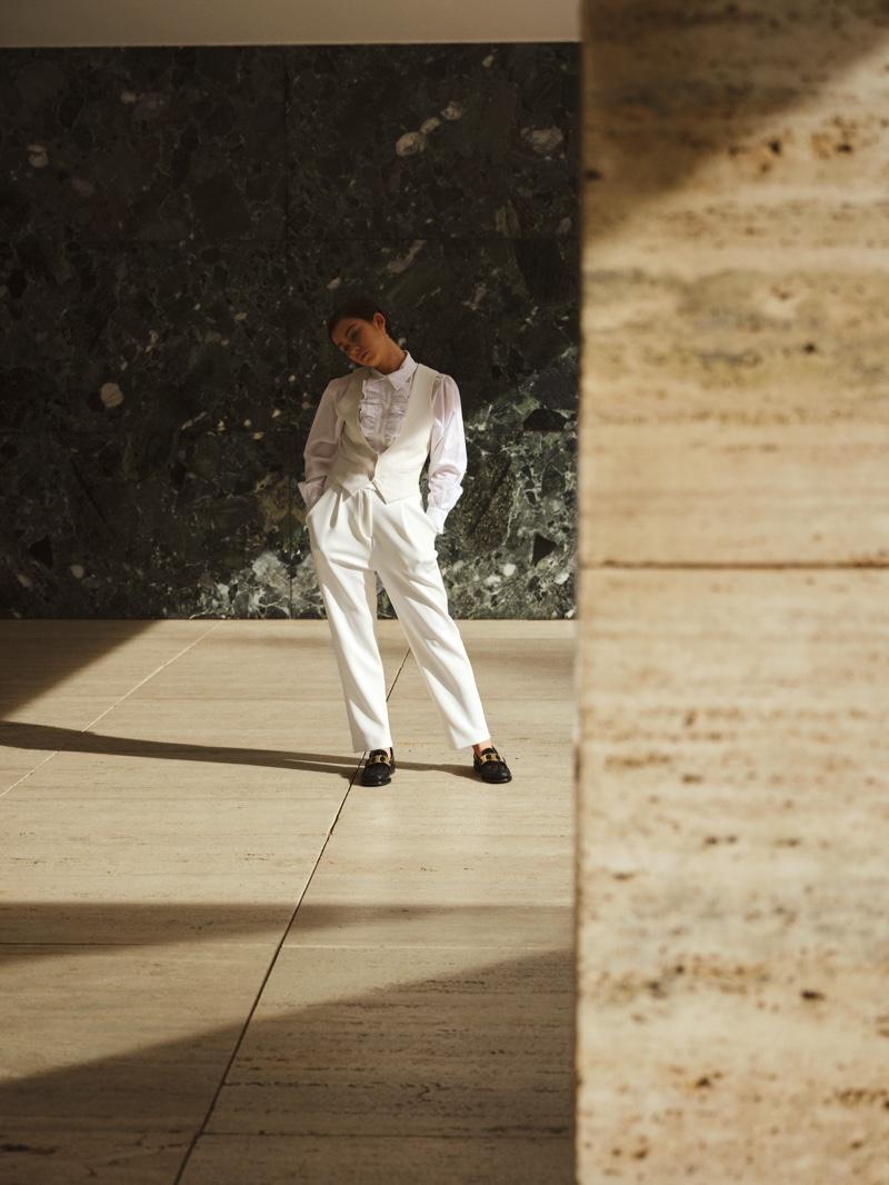 Greta Fernandez wears an all white ensemble