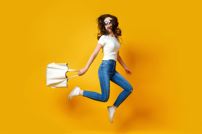 Jumping Woman White T-Shirt Skinny Jeans Bag