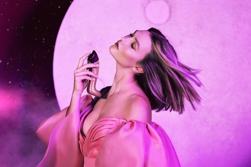 Model Karlie Kloss poses for Carolina Herrera Good Girl Fantastic Pink perfume