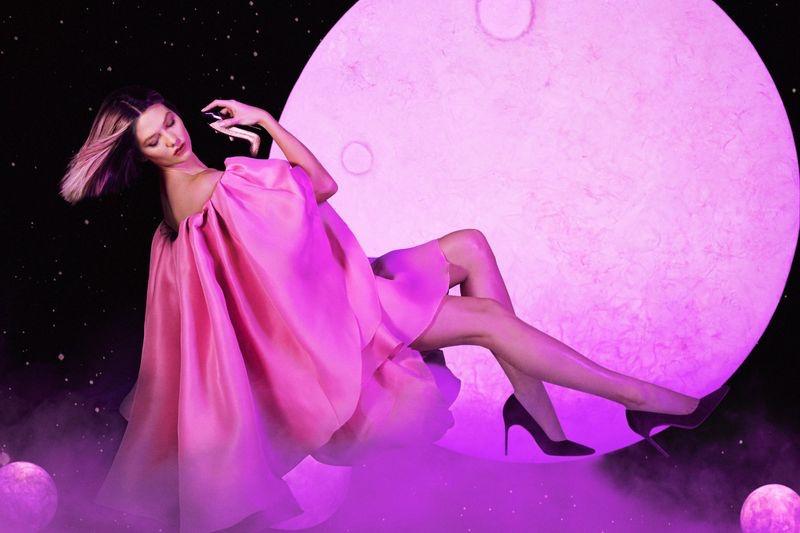 Looking pretty in pink, Karlie Kloss poses for Carolina Herrera Good Girl Fantastic Pink perfume