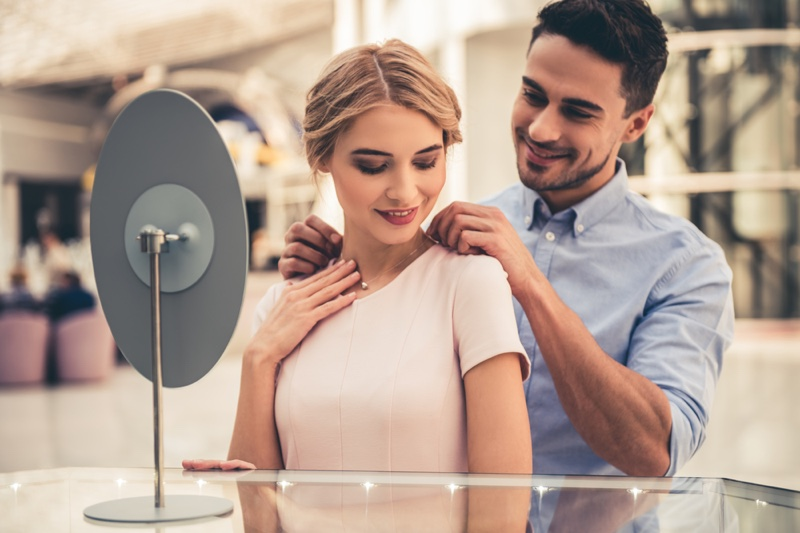 Man Gifting Woman Necklace Couple Jewelry Store