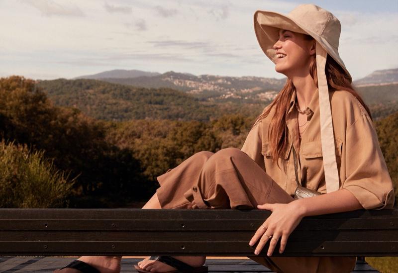 Flashing a smile, Luna Bijl poses in Mango's spring 2020 styles