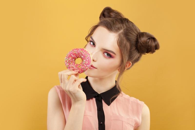 Model Beauty Pink Donut Bun Hairstyle