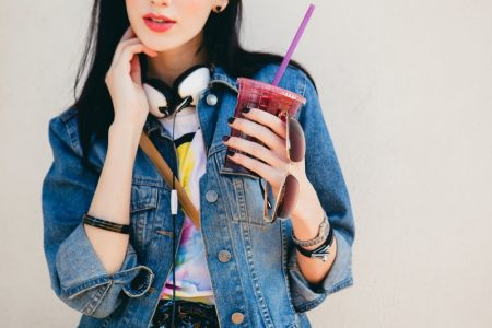 Model Denim Jacket Holding Drink Sunglasses