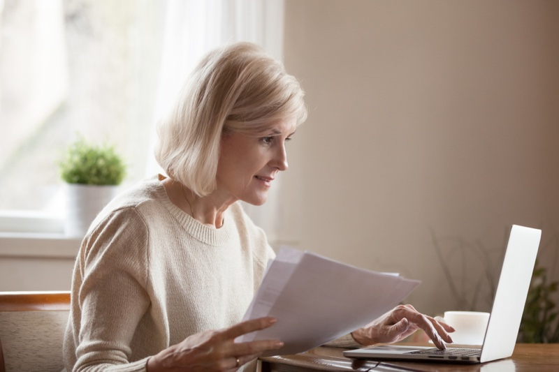 Older Woman Papers Laptop