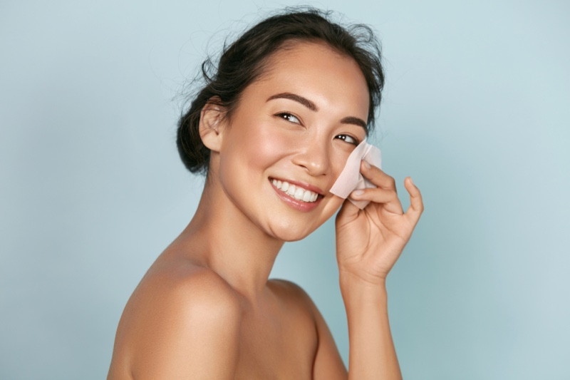 Smiling Asian Model Oil Blotter Beautiful Skin