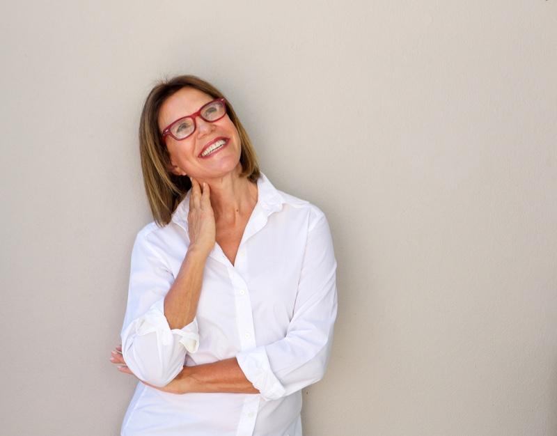 Smiling Older Woman Red Glasses White Shirt