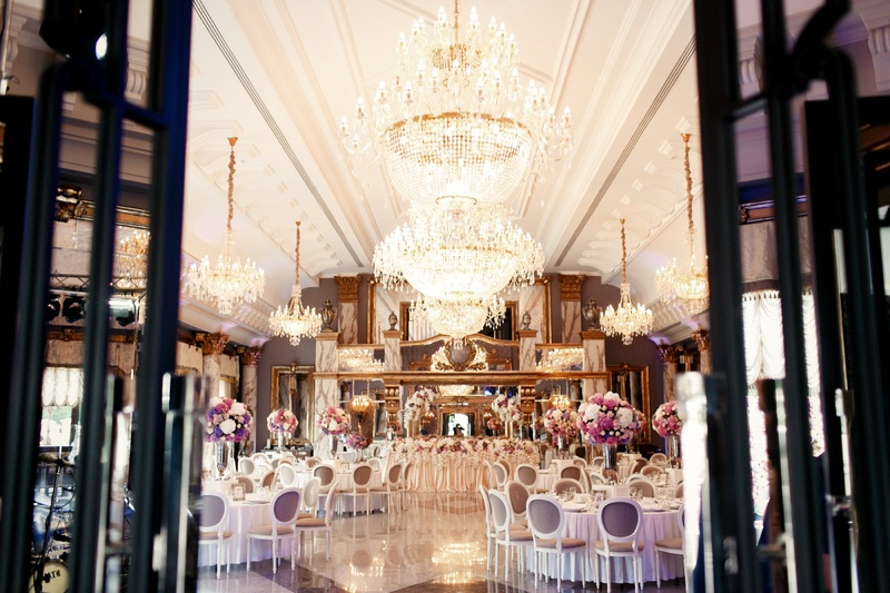 Wedding Venue Chandeliers Chairs Tables Wide Shot