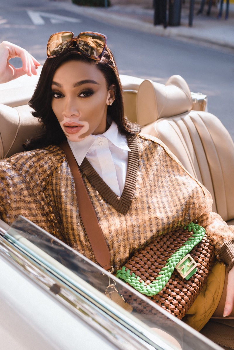Winnie Harlow poses in a convertible for Fendi #BaguetteFriendsForever campaign