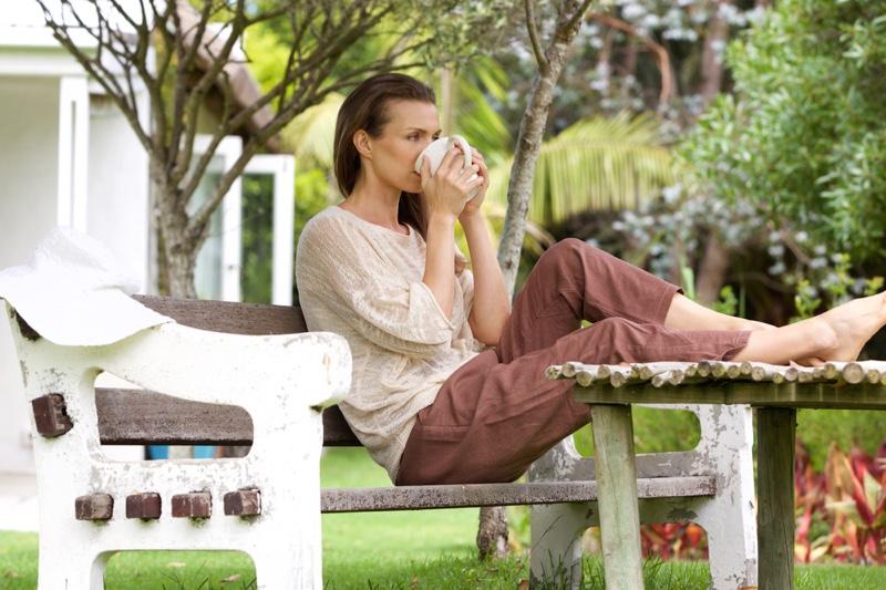Woman Relaxing Outdoors Drinking Cup