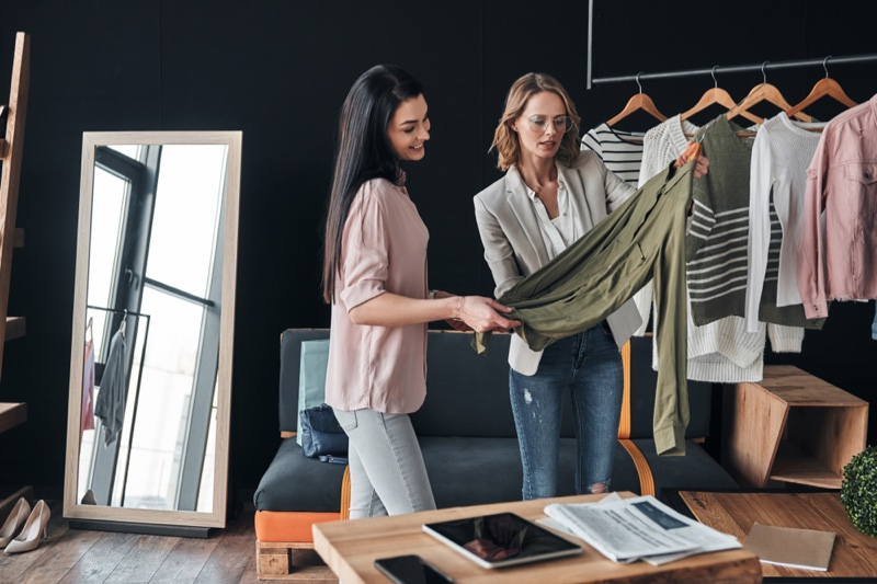 Women Stylist Looking at Clothes Studio