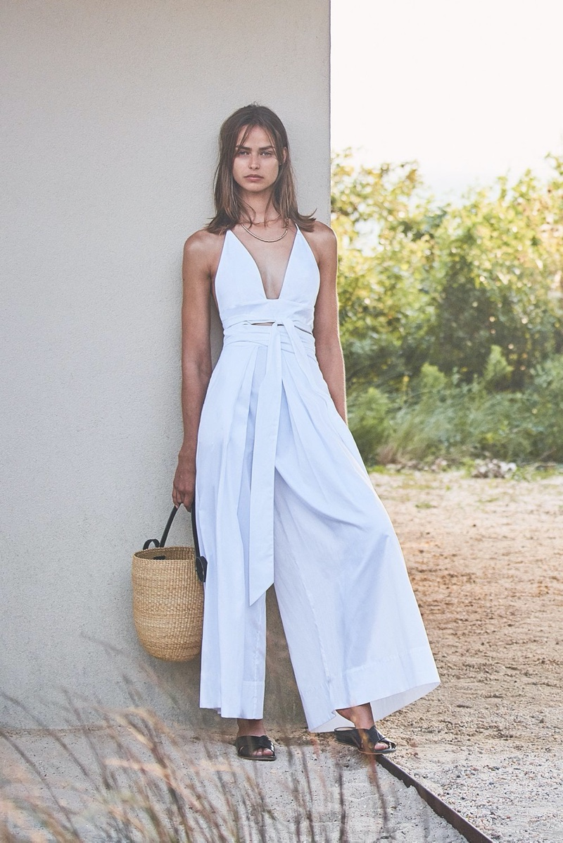 Dressed in white, Birgit Koss poses for Alexis spring-summer 2020 campaign