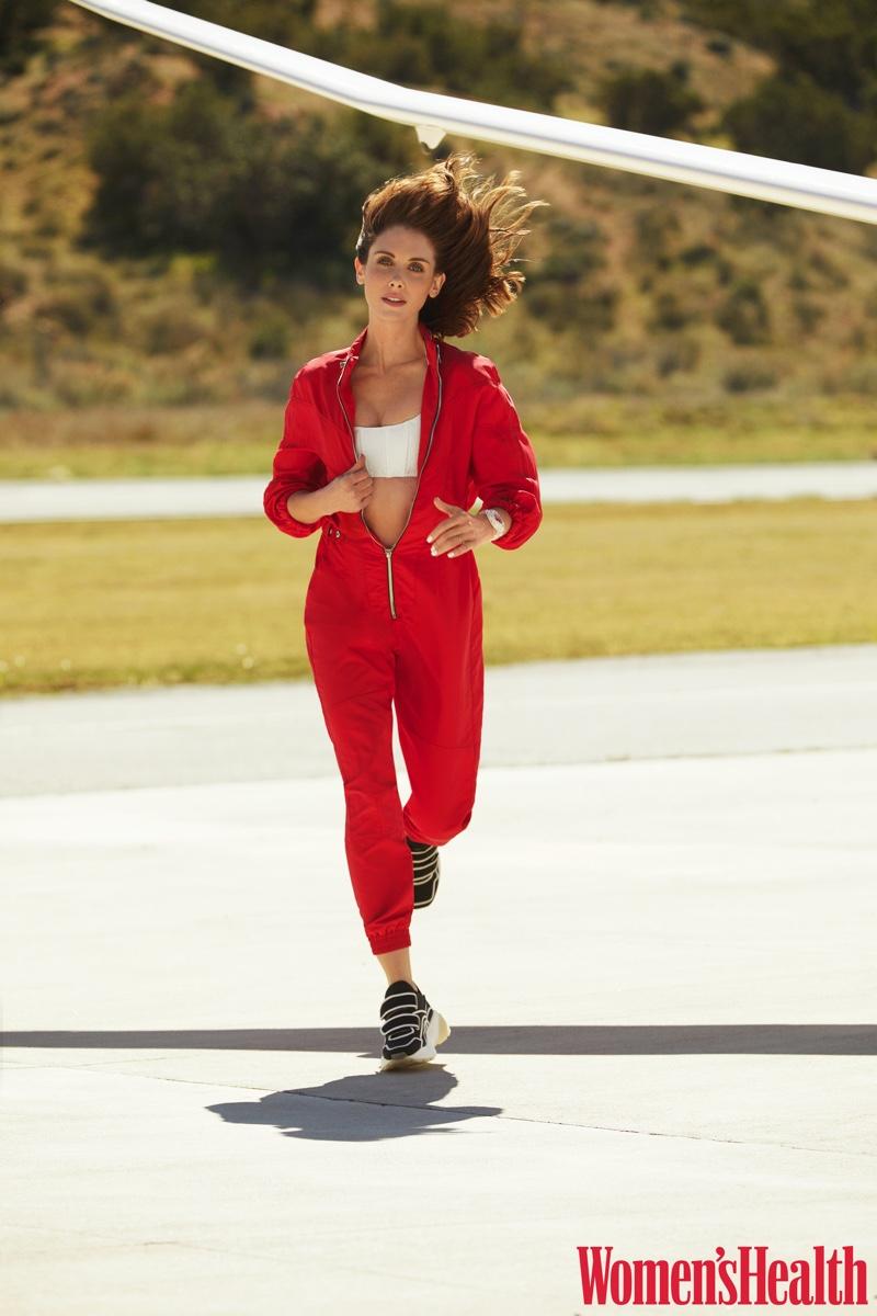 Going for a run, Alison Brie wears RtA Brand jumpsuit, Lisa Marie Fernandez bikini top and Stella McCartney sneakers