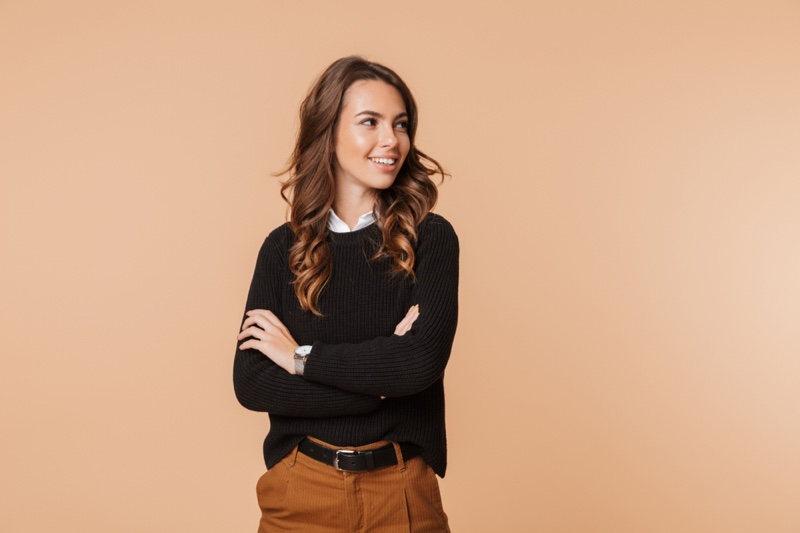 Attractive Woman Arms Crossed Black Sweater Smile