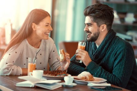 Couple Cafe Sandwiches Smiling Drinking