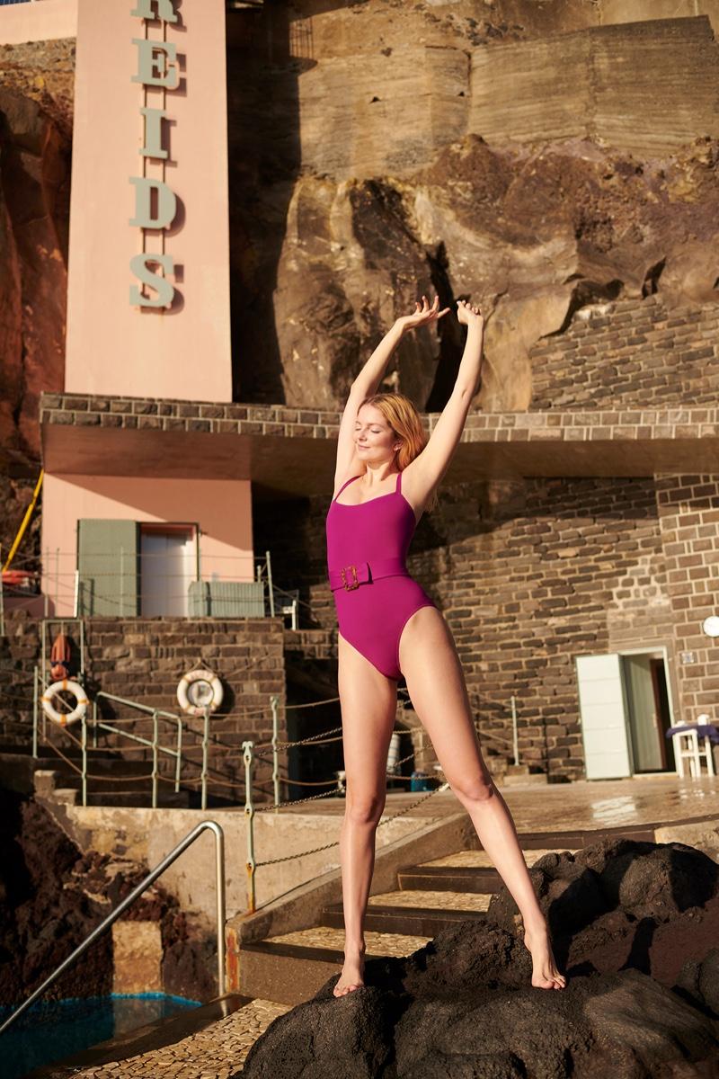 Eniko Mihalik poses in Eres swimsuit for KaDewe.
