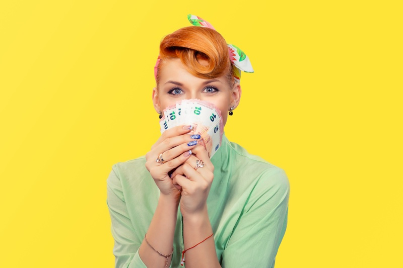 Excited Redhead Woman Money Retro Inspired