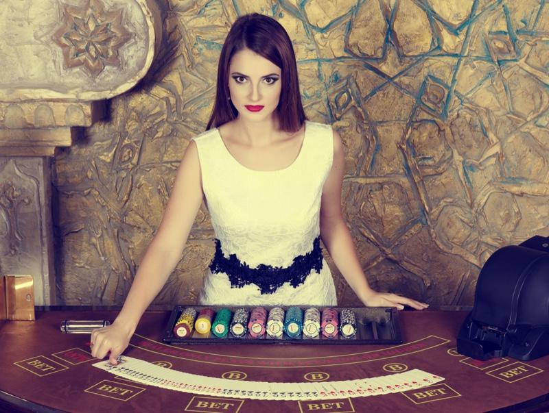 Female Dealer Croupier White Dress Casino