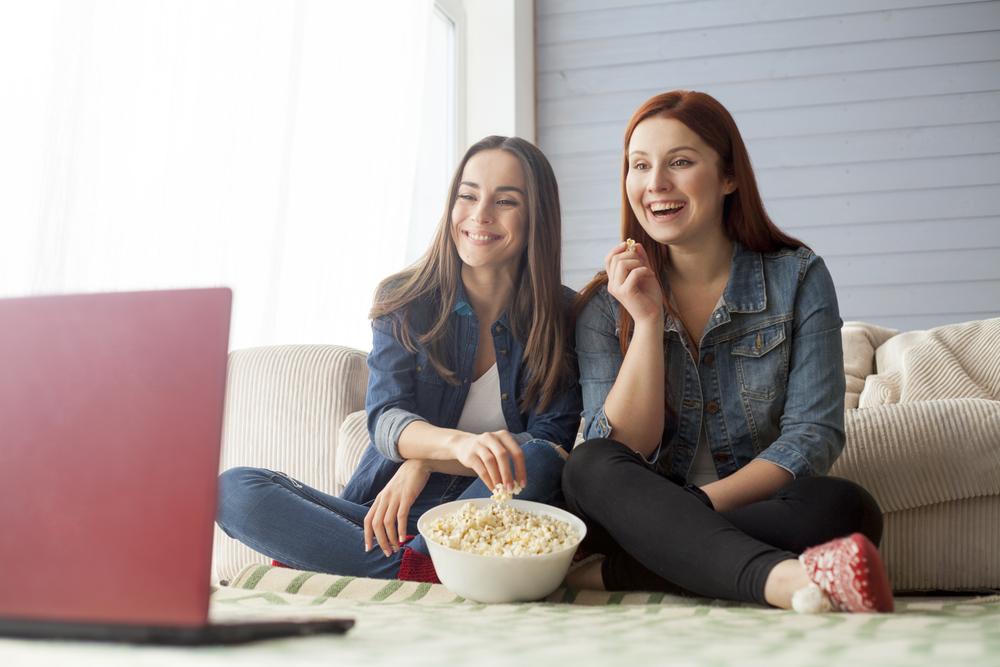 Girlfriends Watching Laptop Eating Popcorn