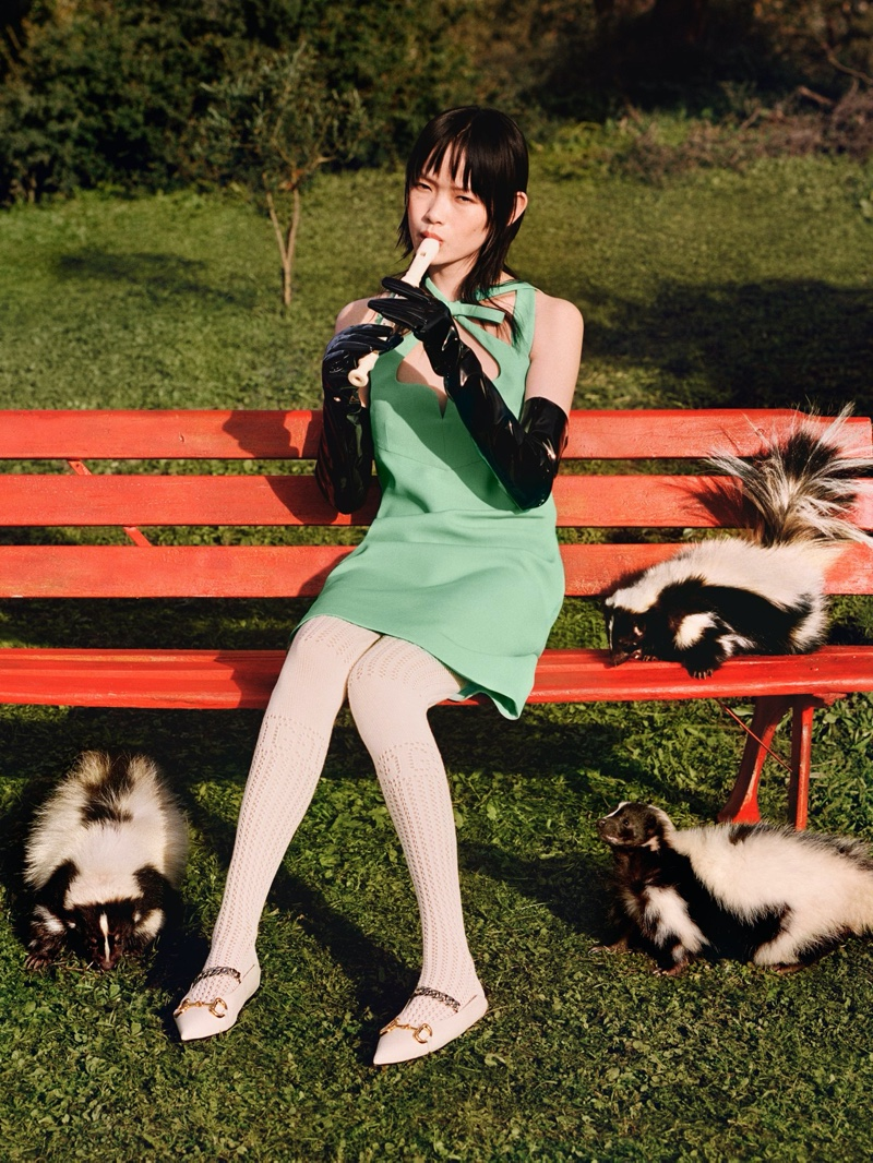 A model poses with skunks in Gucci's pre-fall 2020 campaign.