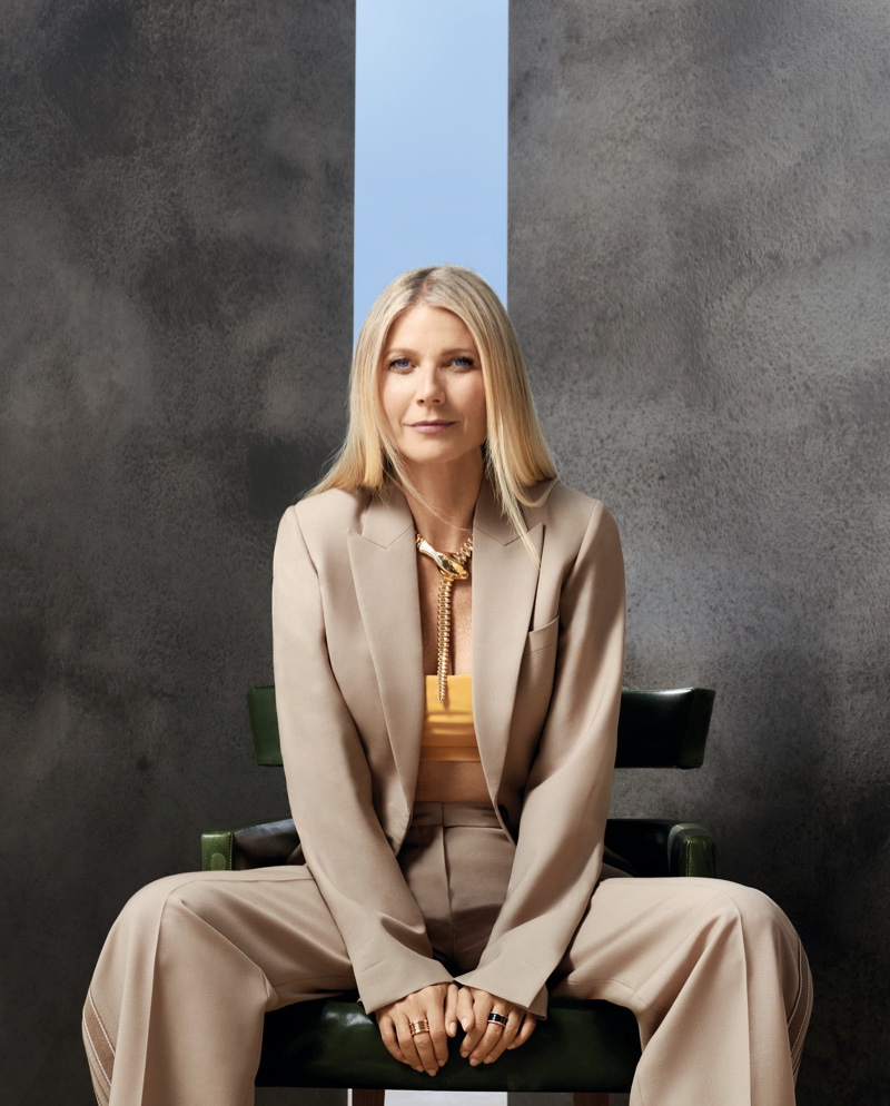 All smiles, Gwyneth Paltrow poses in Hermes jacket and pants with Anemone bikini top