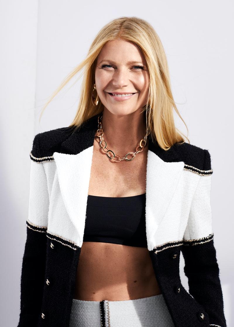 Gwyneth Paltrow wears Chanel jacket and skirt with Eres bikini top