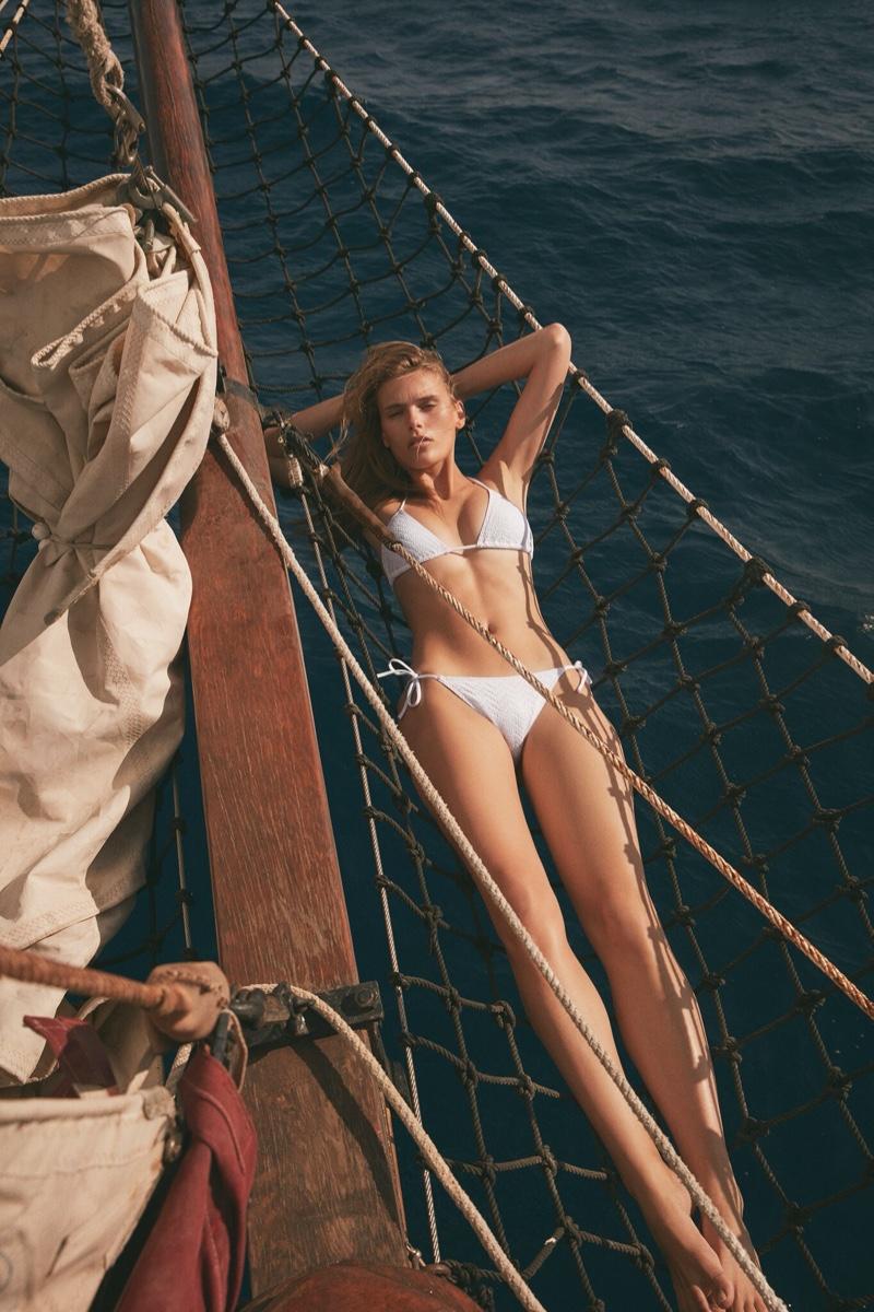 Wearing a white bikini, Madison Headrick fronts Eres spring-summer 2020 campaign