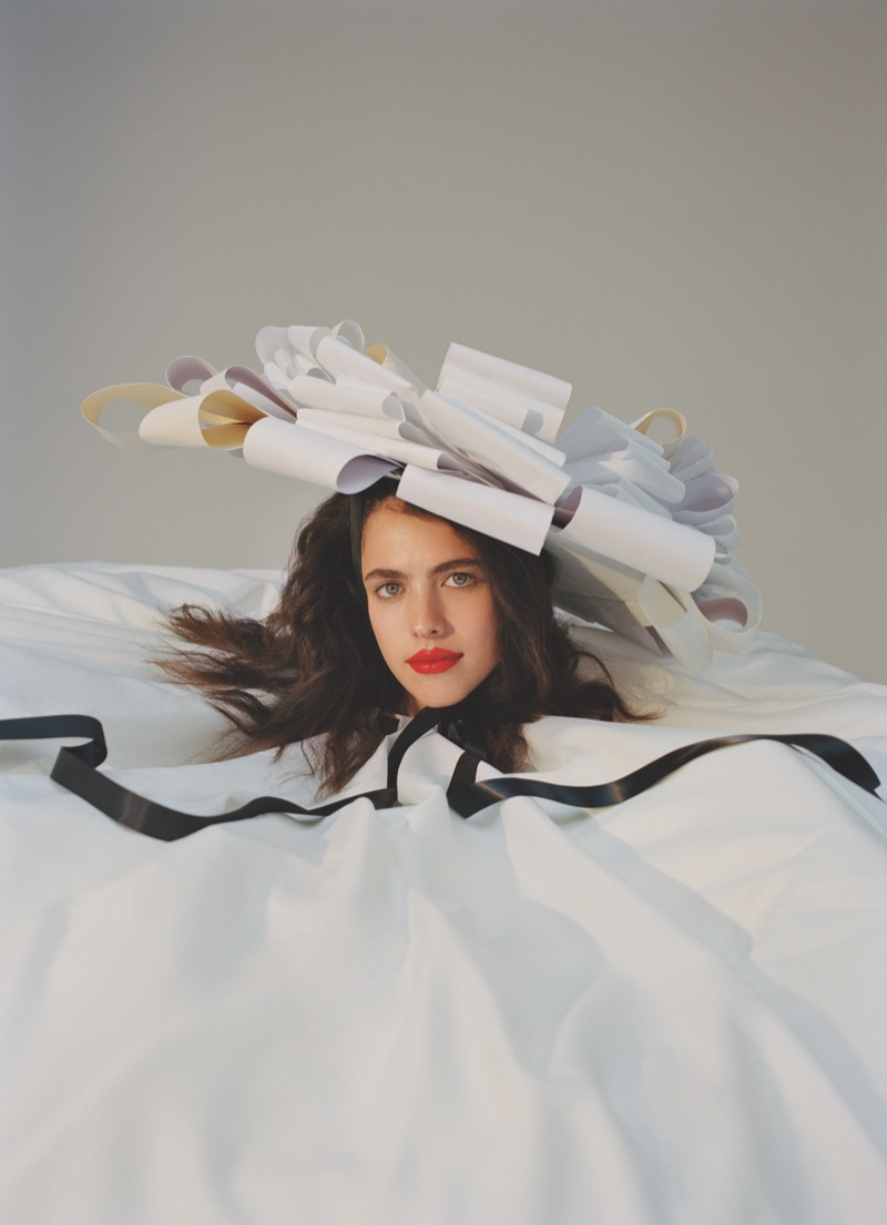 Actress Margaret Qualley tries on whimsical hat and gown. Photo: Daria Kobayashi Ritch for Hunger Magazine