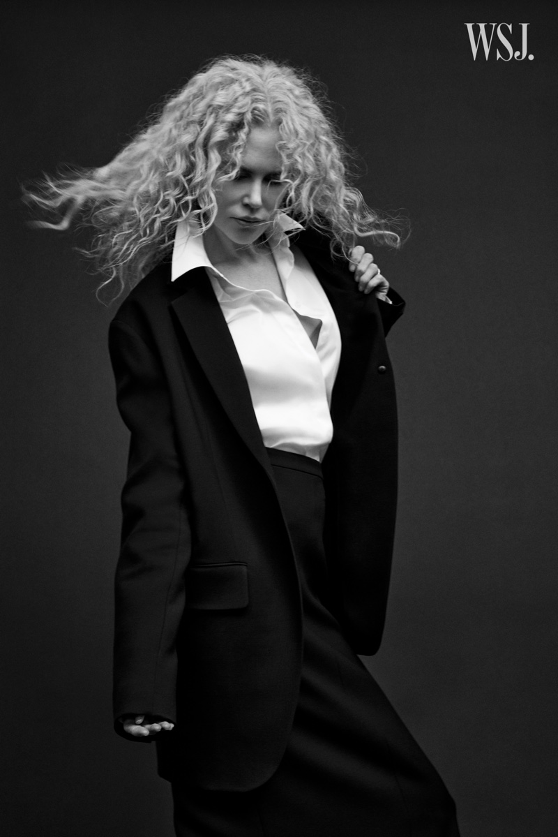 Suiting up, Nicole Kidman poses in black and white image.