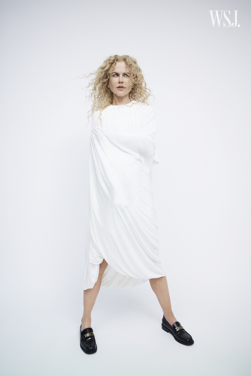 Actress Nicole Kidman poses in a white dress.