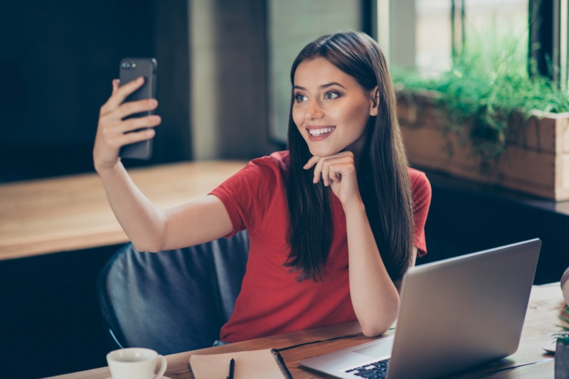 Smiling Brunette Woman Phone Laptop Influencer