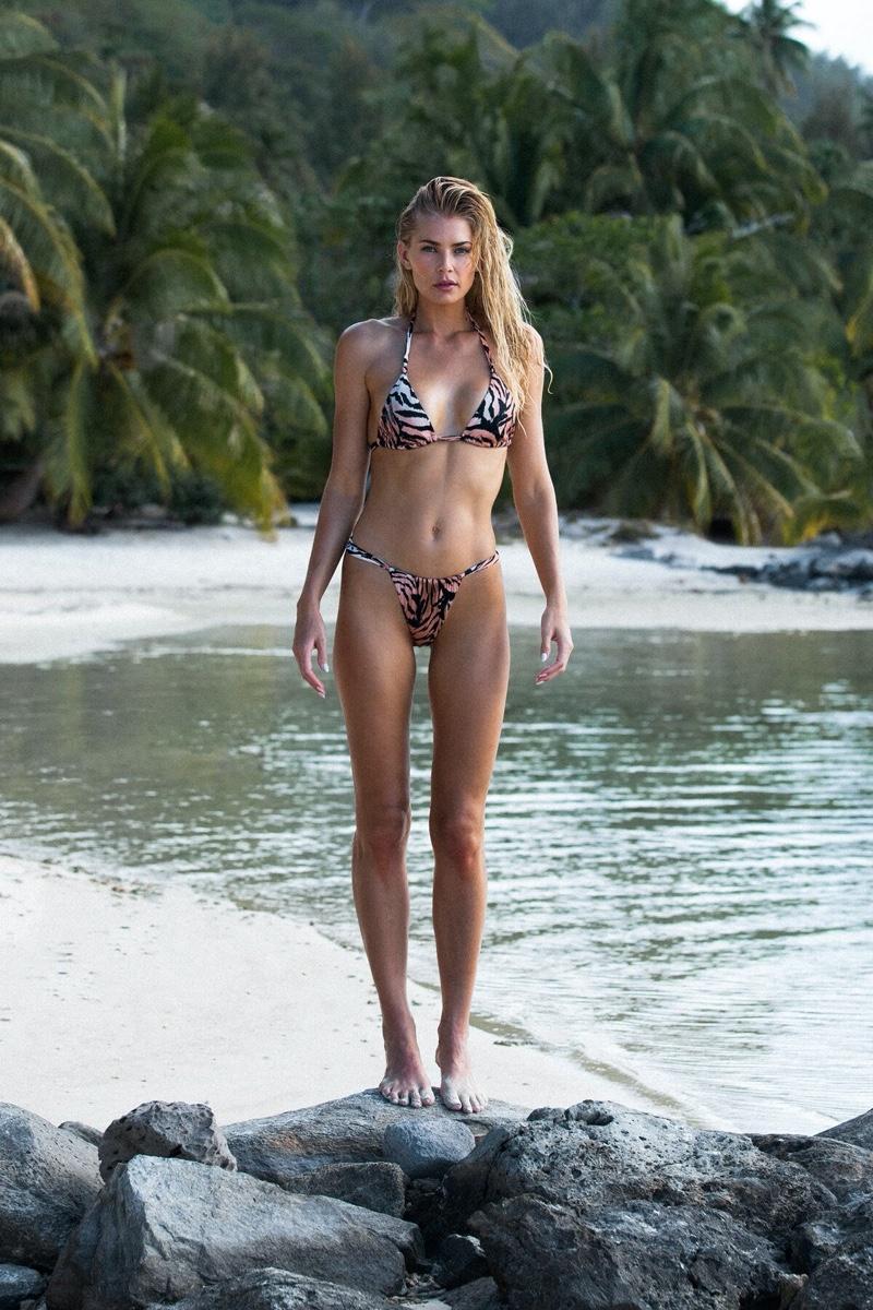 Model Tori Praver wears tiger stripe bikini from her swimwear brand.