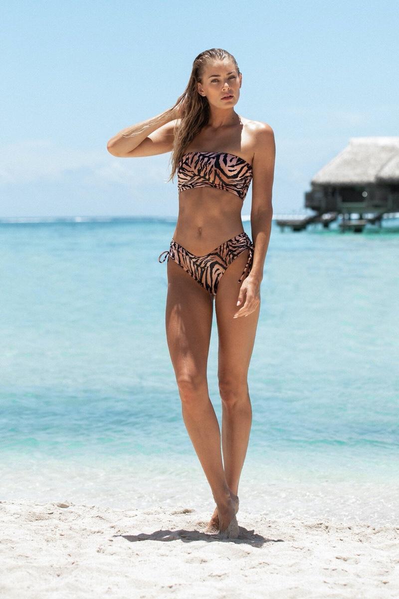 Model Tori Praver poses on the beach for Tori Praver Swimwear spring-summer 2020 campaign.
