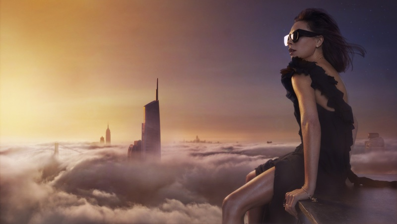 The designer looks over the clouds in Victoria Beckham dress and sunglasses. Photo: An Le