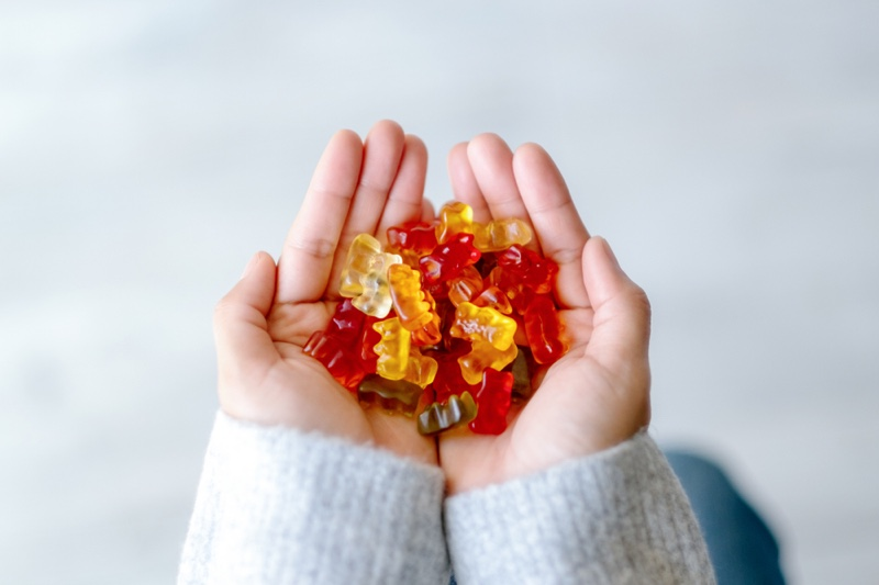 Woman Holding Gummies