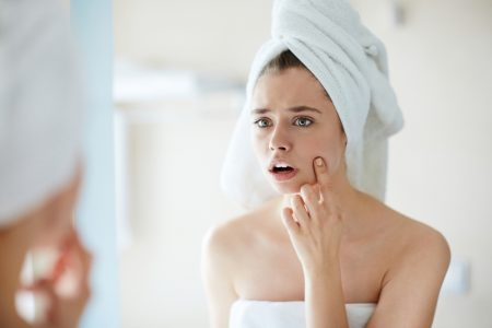 Woman Noticing Pimple