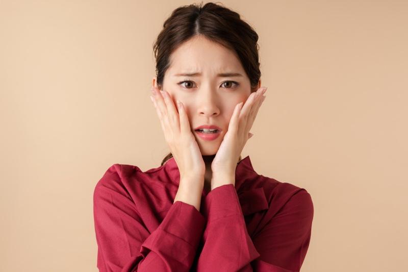 Worried Anxious Asian Woman