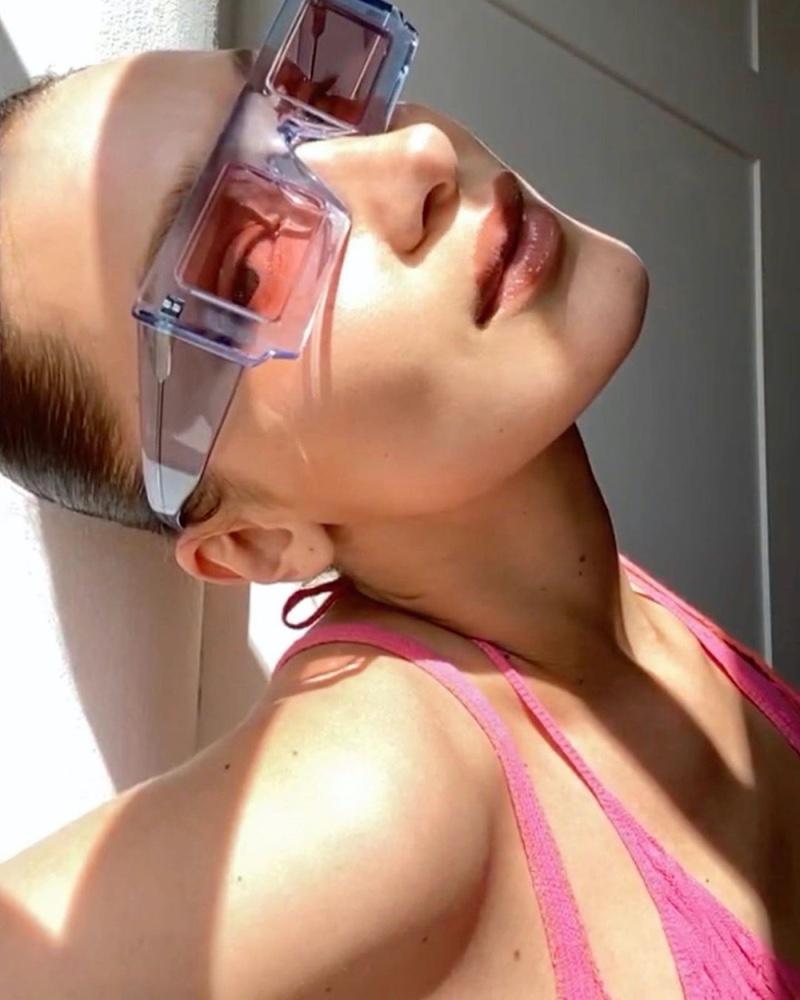 Rocking sunglasses, Bella Hadid models for Jacquemus spring-summer 2020 digital campaign.