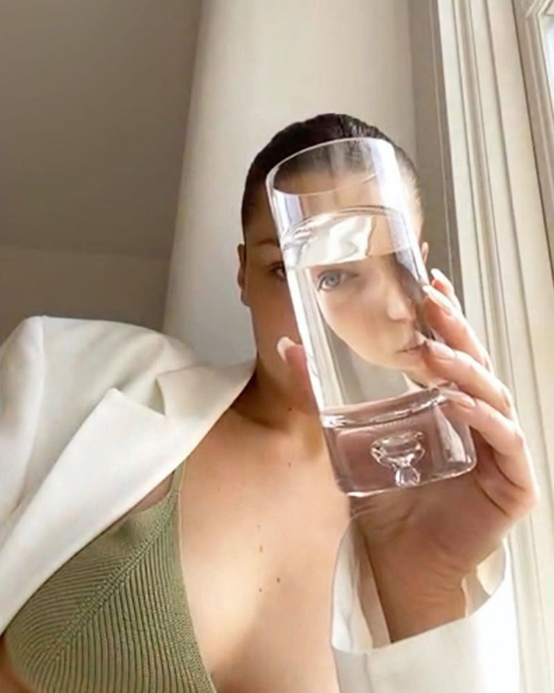 Posing with a glass of water, Bella Hadid fronts Jacquemus spring-summer 2020 digital campaign.