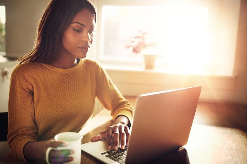 Black Woman Laptop Yellow Sweater