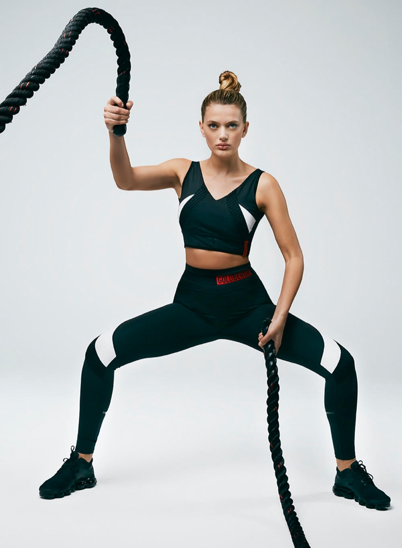 Using ropes, Bregje Heinen works out in Goldbergh Activewear spring-summer 2020 campaign.