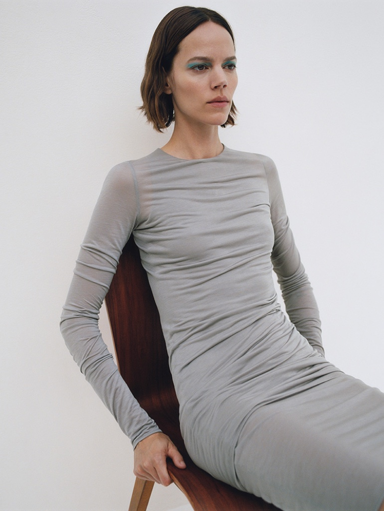 COS highlights double layer long-sleeve dress in spring 2020 campaign.