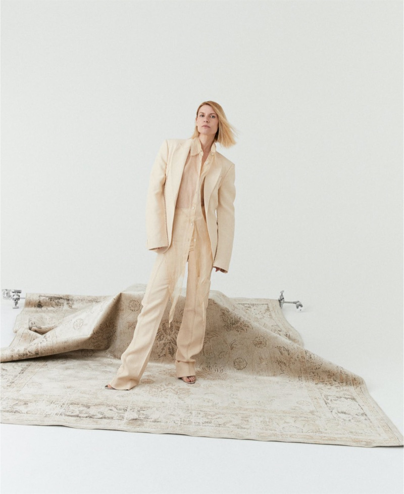 Suiting up, Claire Danes poses in Acne Studios blazer, shirt and trousers with Christian Louboutin heels.