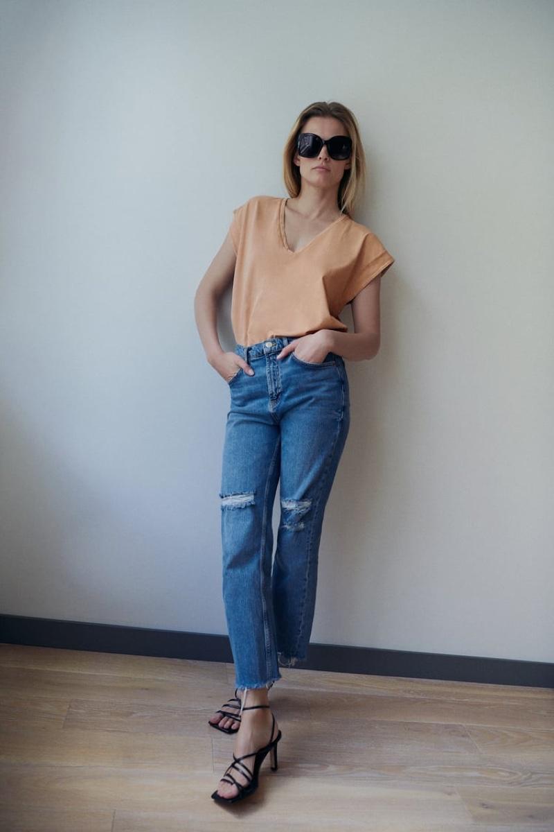 Keeping it casual, Edita Vilkeviciute models Zara's new arrivals.