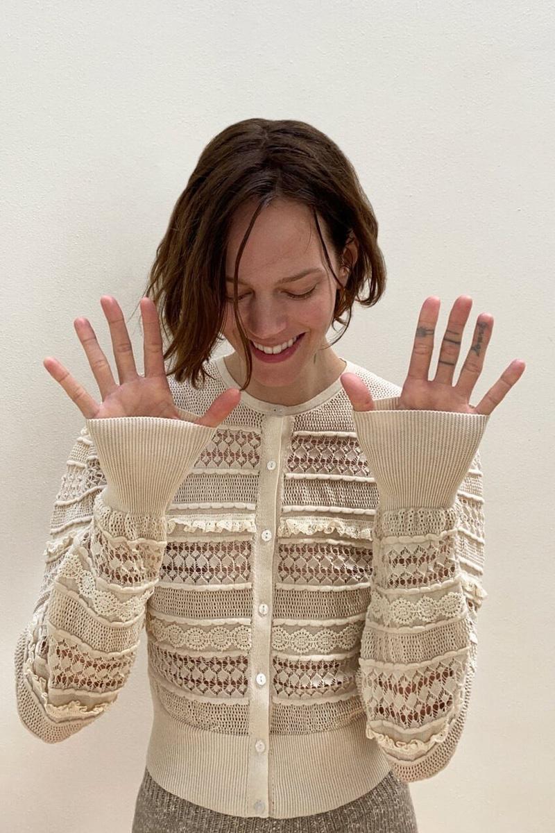 Model Freja Beha Erichsen poses in Zara combination knit cardigan.