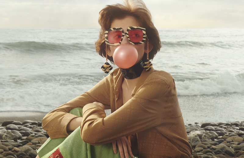 A model poses with bubblegum in Gucci's limited edition eyewear campaign.