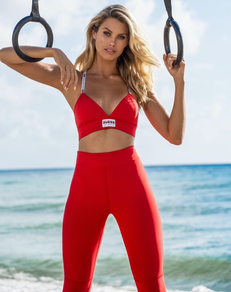 Looking red-hot, Natalie Roser poses in Guess activewear 2020 campaign.