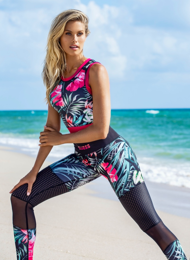 Hitting the beach, Natalie Roser poses for Guess activewear 2020 campaign.